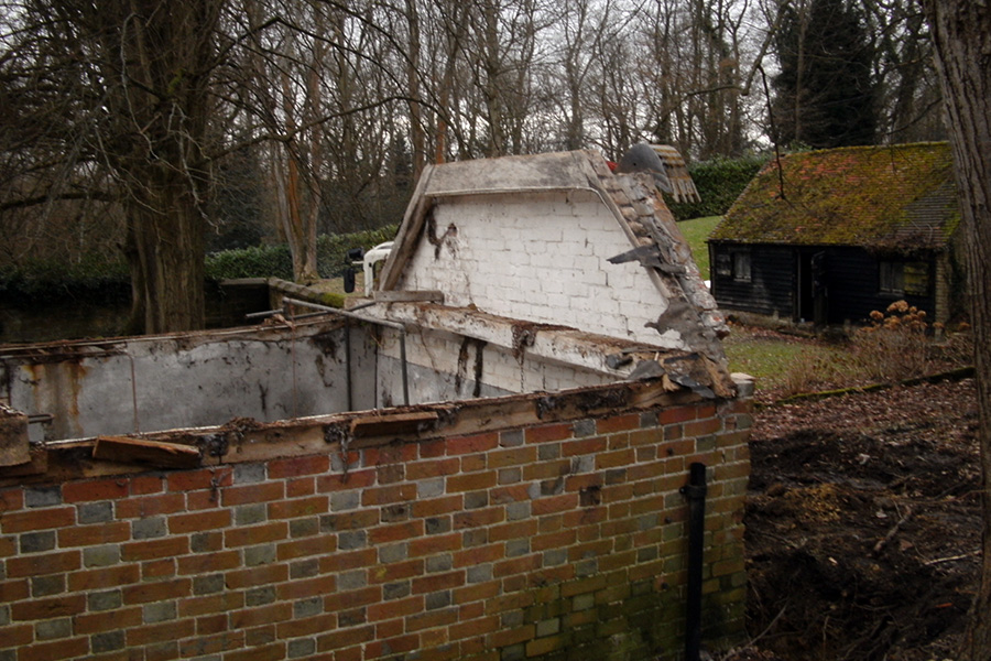 Before: The shell of the old pool house